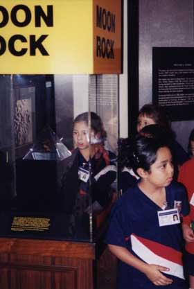 Students Examining an Actual Moon Rock